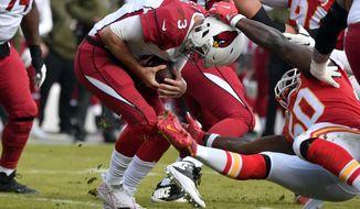 Arizona Cardinals quarterback Josh Rosen (3) escapes a tackle attempt by Kansas City Chiefs linebacker Justin Houston (50) during the first half of an NFL football game in Kansas City, Mo., Sunday, Nov. 11, 2018. (AP Photo/Ed Zurga)