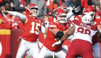 Kansas City Chiefs quarterback Patrick Mahomes (15) throws a pass during the first half of an NFL football game against the Arizona Cardinals in Kansas City, Mo., Sunday, Nov. 11, 2018. (AP Photo/Ed Zurga)