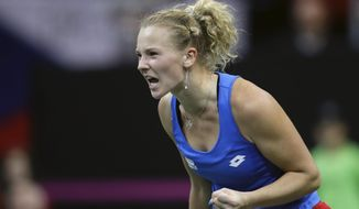 Katerina Siniakova of the Czech Republic reacts after scoring a point against Sofia Kenin of the United States during their tennis match of the Fed Cup Final between Czech Republic and United States in Prague, Czech Republic, Sunday, Nov. 11, 2018. (AP Photo/Petr David Josek)