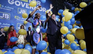 FILE - In this Tuesday, Nov. 6, 2018, file photo, Democratic gubernatorial candidate J.B. Pritzker, right, and his running mate Lt. Governor candidate Juliana Stratton celebrate as they wave to supporters after they won over Republican incumbent Bruce Rauner in Chicago. Democrats who gained new or expanded powers in state elections are gearing up for a left-leaning push on gun control, universal health care and legal marijuana. Meanwhile, some Republican legislatures that have cut taxes and limited union powers are adjusting to a new reality of needing to work with a Democratic governor. The midterm elections Tuesday, Nov. 6, increased Democratic relevance in state capitols that have been dominated by Republicans during the past decade. (AP Photo/Nam Y. Huh, File)