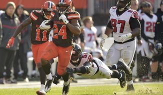 Cleveland Browns running back Nick Chubb (24) rushes for a 92-yard touchdown as Atlanta Falcons linebacker Foye Oluokun (54) misses the tackle in the second half of an NFL football game, Sunday, Nov. 11, 2018, in Cleveland. (AP Photo/David Richard)