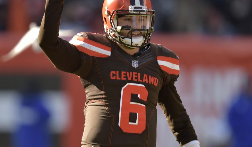 Cleveland Browns quarterback Baker Mayfield celebrates a 13-yard pass to runningback Nick Chubb in the first half of an NFL football game against the Atlanta Falcons, Sunday, Nov. 11, 2018, in Cleveland. (AP Photo/David Richard)