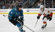 San Jose Sharks' Brenden Dillon (4) carries the puck against Calgary Flames' Matthew Tkachuk (19) in the first period of an NHL hockey game in San Jose, Calif., Sunday, Nov. 11, 2018. (AP Photo/Josie Lepe) ** FILE **