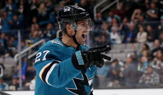 San Jose Sharks' Joonas Donskoi (27) celebrates after scoring goal against the Calgary Flames in the second period of an NHL hockey game in San Jose, Calif., Sunday, Nov. 11, 2018. (AP Photo/Josie Lepe)