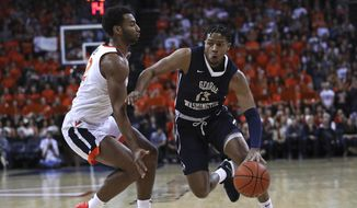 George Washington's DJ Williams (13) drives past Virginia guard Braxton Key (2) in the first half of an NCAA college basketball game Sunday, Nov. 11, 2018, in Charlottesville, Va.  (Zack Wajsgras /The Daily Progress via AP) **FILE**