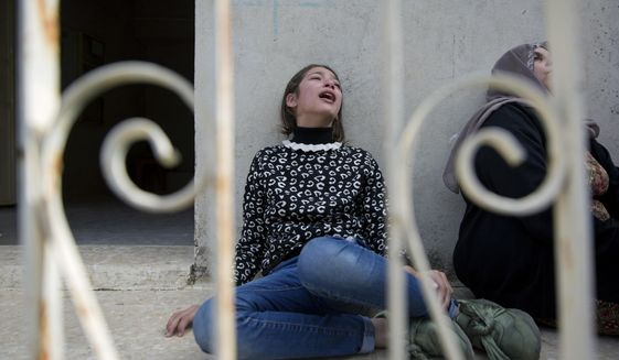 Mourners cry during the funeral of Palestinian Mohammed Shreteh, in the West Bank village of Mazraa al-Gharbiya, near Ramallah, Sunday, Nov. 11, 2018. Shreteh succumbed to his wounds that were sustained during clashes with Israeli soldiers in the village last month. (AP Photo/Nasser Nasser)