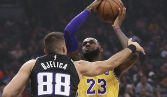 Los Angeles Lakers forward LeBron James, right, is fouled by Sacramento Kings forward Nemanja Bjelica during the second quarter of an NBA basketball game Saturday, Nov. 10, 2018, in Sacramento, Calif. .(AP Photo/Rich Pedroncelli)o