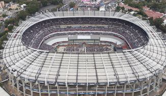 FILE - In this June 27, 2018, file photo, supporters of presidential candidate Andres Manuel Lopez Obrador, of the MORENA party, fill Azteca stadium as they wait for him to arrive for his closing campaign rally in Mexico City. The abused hybrid grass of the Azteca Stadium is generating concerns for its poor condition a week before it hosts an NFL regular-season game between the Los Angeles Rams and the Kansas City Chiefs. Last May, stadium authorities changed the surface from natural to hybrid. But the intense activity in the last few months has prevented the grass from reaching an optimum state. (AP Photo/Christian Palma, File) **FILE**
