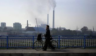 In this Sunday, Oct. 21, 2018 photo, smokes billows from the chimneys of Pyongyang Power Plant in Pyongyang, North Korea. Twenty years after his father almost bargained them away for a pair of nuclear reactors, North Korean leader Kim Jong Un has his nuclear weapons - and a nation still plagued by chronic blackouts. But years of sanctions have spurred the North to cobble together a creative smorgasbord of alternative resources, some off the official grid and some flat-out illegal. (AP Photo/Dita Alangkara)