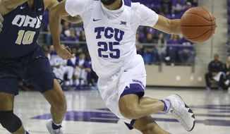Oral Roberts guard Sam Kearns (10) tries to defend against the drive by TCU guard Alex Robinson (25) in the first half an NCAA college basketball game Sunday, Nov. 11, 2018, in Dallas. (AP Photo/Richard W. Rodriguez)