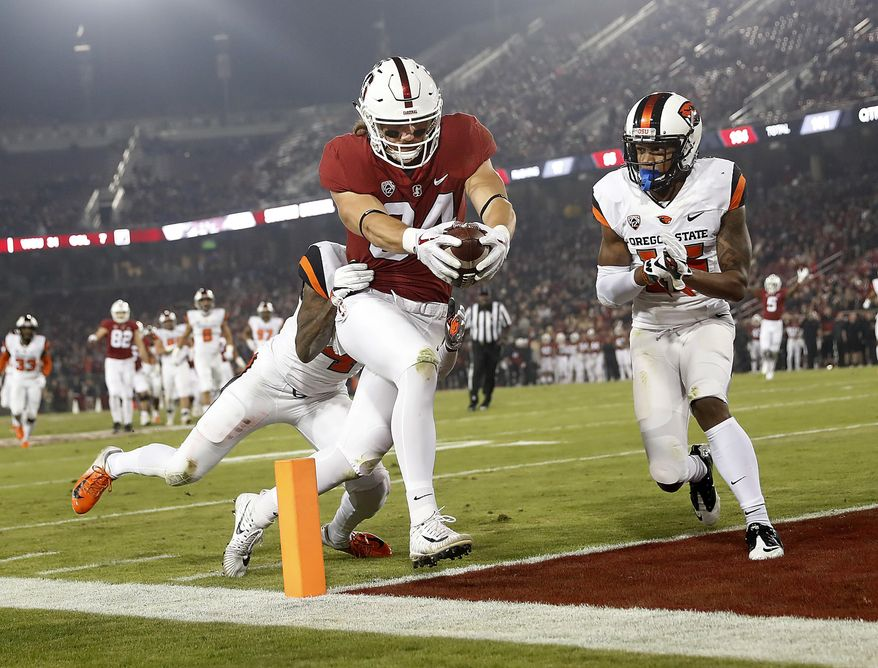 Stanford tight end Colby Parkinson (84) scores a touchdown past Oregon State safety Jeffrey Manning Jr. (15) in the first half during an NCAA college football game on Saturday, Nov. 10, 2018, in Stanford, Calif. (AP Photo/Tony Avelar)
