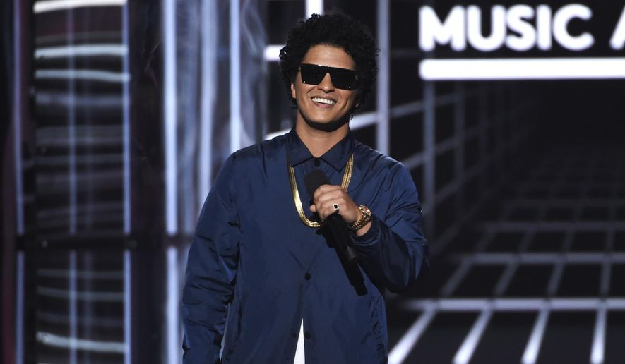 In this May 20, 2018, file photo, Bruno Mars presents the Icon award at the Billboard Music Awards at the MGM Grand Garden Arena in Las Vegas. (Photo by Chris Pizzello/Invision/AP, File)