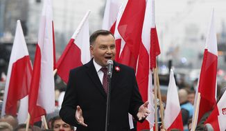 Poland's President Andrzej Duda speaks at the start of a massive march marking 100 years since Poland regained independence in Warsaw, Poland, Sunday, Nov. 11, 2018. (AP Photo/Czarek Sokolowski)