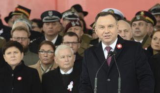 Polish President Andrzej Duda, right, speaks during the official ceremony marking Poland's Independence Day, in Warsaw, Poland, Sunday, Nov. 11, 2018, as leader of the ruling Law and Justice party, Jaroslaw Kaczynski, second left, stands behind. (AP Photo/Alik Keplicz) ** FILE **