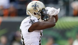 New Orleans Saints wide receiver Michael Thomas celebrates his touchdown in the first half of an NFL football game against the Cincinnati Bengals, Sunday, Nov. 11, 2018, in Cincinnati. (AP Photo/Gary Landers)2