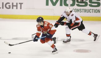 Florida Panthers center Denis Malgin (62) defends against Ottawa Senators right wing Bobby Ryan (9) during the first period of an NHL hockey game on Sunday, Nov. 11, 2018 in Sunrise, Fla. (AP Photo/Terry Renna)