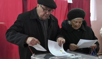 People cast their ballots at a polling station during rebel elections in Donetsk, Ukraine, Sunday, Nov. 11, 2018. Residents of the eastern Ukraine regions controlled by Russia-backed separatist rebels are voting for local governments in elections denounced by Kiev and the West. (AP Photo)