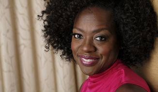 "This Sept. 9, 2018 photo shows Viola Davis, a cast member in the film ""Widows,"" posing for a portrait at the Ritz-Carlton Hotel during the Toronto International Film Festival in Toronto. (Photo by Chris Pizzello/Invision/AP)"