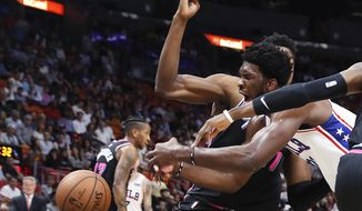 Philadelphia 76ers center Joel Embiid goes for the ball against the Miami Heat in the first quarter of an NBA basketball game Monday, Nov. 12, 2018, in Miami. (AP Photo/Brynn Anderson)