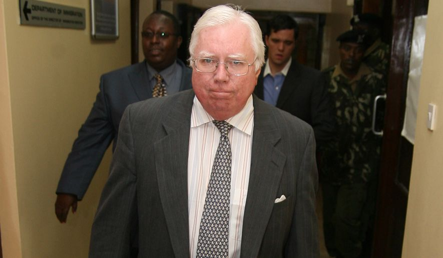 "Jerome Corsi, who wrote ""The Obama Nation: Leftist Politics and the Cult of Personality, walks down a corridor Tuesday, Oct. 7, 2008 as he arrives at the immigration department in Nairobi, Kenya.  Corsi, was picked up at his hotel in Nairobi on Tuesday morning. He was briefly detained before being brought to the airport for deportation, said Joseph Mumira, head of criminal investigations at Jomo Kenyatta International Airport. (AP Photo) **  KENYA OUT **"