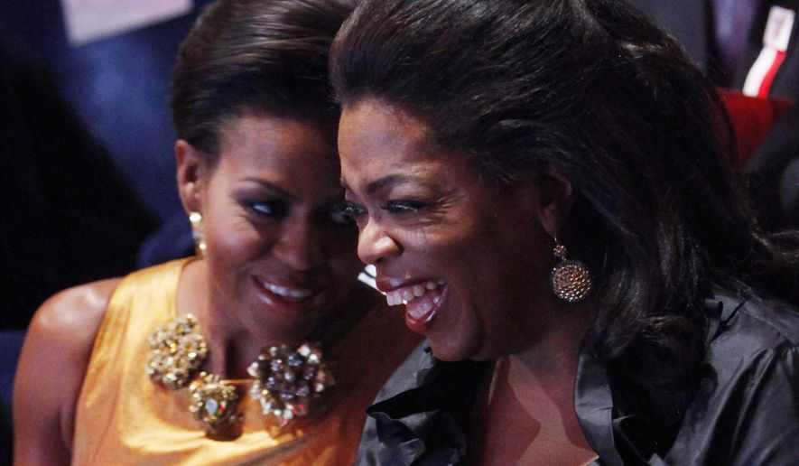 U.S. first lady Michelle Obama sits with television talk show host Oprah Winfrey, at the opening ceremonies of the the 121st International Olympic Committee (IOC) Session and XIII Olympic Congress at the Copenhagen Opera House, Thursday, Oct. 1, 2009, in Copenhagen. Chicago, Madrid, Rio de Janeiro and Tokyo are competing to host the 2016 Summer Olympic Games and the IOC will choose the winning city in a vote on Friday, Oct. 2, in Copenhagen. (AP Photo/Charles Dharapak, Pool)