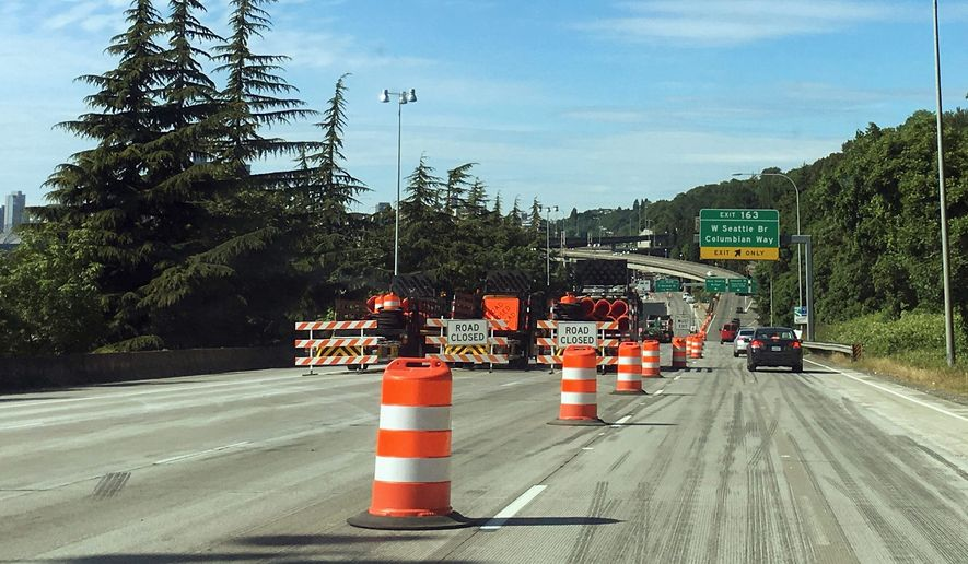 Northbound Interstate 5 south of Seattle is shown closed at the West Seattle Bridge exit, Saturday, June 2, 2018, in Seattle. The Washington State Dept. of Transportation and its contractors shut down the freeway from the bridge exit to the Olive Way exit in downtown Seattle from Friday night through early Monday morning to complete major repair and renovation work on the roadway. Lane closures south of the full closure added to congestion and drivers were encouraged to use alternate routes. (AP Photo/Ted S. Warren)