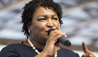Georgia Democratic gubernatorial candidate Stacey Abrams speaks to supporters at a rally, Monday, Nov., 5, 2018, in Richmond Hill, Ga. Republican candidate Brian Kemp and Abrams are locked in a tight race that could head to a runoff if neither wins a majority Tuesday. (AP Photo/Stephen B. Morton)