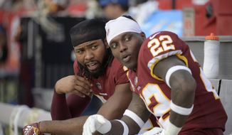 Washington Redskins cornerback Josh Norman, left, and defensive back Deshazor Everett (22) watch from the bench during the second half of an NFL football game against the Tampa Bay Buccaneers Sunday, Nov. 11, 2018, in Tampa, Fla. (AP Photo/Phelan M. Ebenhack) **FILE**