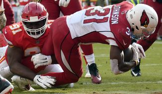 Arizona Cardinals running back David Johnson (31) scores a touchdown past Kansas City Chiefs defensive lineman Derrick Nnadi (91) during the second half of an NFL football game in Kansas City, Mo., Sunday, Nov. 11, 2018. (AP Photo/Ed Zurga)
