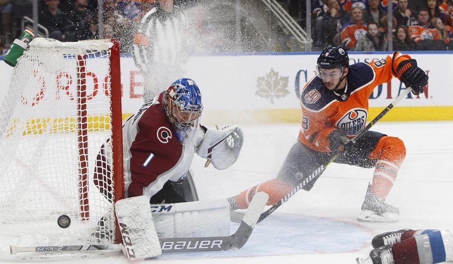 Colorado Avalanche goalie Semyon Varlamov (1) makes the save on Edmonton Oilers' Ty Rattie (8) during second period NHL hockey action in Edmonton, Alberta on Sunday Nov. 11, 2018. (Jason Franson/The Canadian Press via AP)