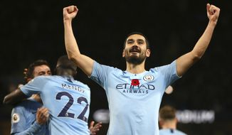 Manchester City's Ilkay Gundogan celebrates after scoring his side's third goal during the English Premier League soccer match between Manchester City and Manchester United at the Etihad stadium in Manchester, England, Sunday, Nov. 11, 2018. (AP Photo/Dave Thompson)