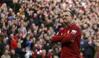 Liverpool's Xherdan Shaqiri celebrates scoring his side's second goal of the game,  during the English Premier League soccer match between Liverpool and Fulham, at Anfield Stadium, in Liverpool, England, Sunday, Nov. 11, 2018. (Barrington Coombs/PA via AP)