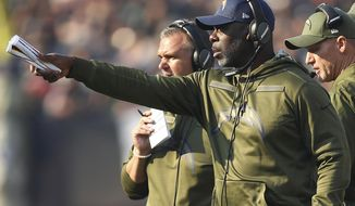 Los Angeles Chargers head coach Anthony Lynn gestures during the first half of an NFL football game against the Oakland Raiders in Oakland, Calif., Sunday, Nov. 11, 2018. (AP Photo/Ben Margot)