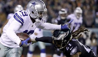 Dallas Cowboys wide receiver Amari Cooper, left, runs with the ball as Philadelphia Eagles cornerback Ronald Darby moves in for the tackle during the first half of an NFL football game, Sunday, Nov. 11, 2018, in Philadelphia. (AP Photo/Matt Rourke)