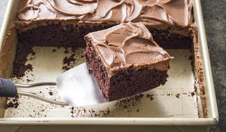 """This undated photo provided by America's Test Kitchen in November 2018 shows a chocolate sheet cake in Brookline, Mass. This recipe appears in the """"Complete Cookbook for Young Chefs."""" (Carl Tremblay/America's Test Kitchen via AP)"""