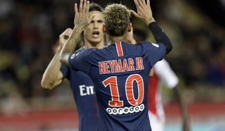 PSG's Neymar celebrates with teammate Edinson Cavani after scoring his side's forth goal during the French League One soccer match between AS Monaco and Paris Saint-Germain at Stade Louis II in Monaco, Sunday, Nov. 11, 2018 (AP Photo/Claude Paris)