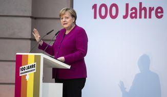 German Chancellor Angela Merkel speaks at an event marking 100 years of voting rights for women in Germany in Berlin, Monday, Nov. 12, 2018. (Bernd von Jutrczenka/dpa via AP)