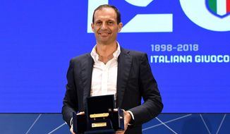 Juventus head coach Massimiliano Allegri poses for photographers with the Panchina d'Oro (Golden Bench) award, in Coverciano, near Florence, Italy, Monday, Nov. 12, 2018.  Allegri has won Serie A's coach of the year award for the fourth time after guiding Juventus to a record-extending seventh straight Serie A title last season. (Claudio Giovannini/ANSA via AP)