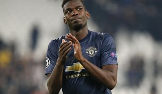 ManU midfielder Paul Pogba applauds fans at the end of the Champions League group H soccer match between Juventus and Manchester United at the Allianz stadium in Turin, Italy, Wednesday, Nov. 7, 2018. Manchester won 2-1. (AP Photo/Antonio Calanni)