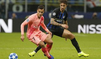 Barcelona's Philippe Coutinho, left, and Inter Milan's Sime Vrsaljko vie for the ball during the Champions League group B soccer match between Inter Milan and Barcelona at the San Siro stadium in Milan, Italy, Tuesday, Nov. 6, 2018. (AP Photo/Antonio Calanni)