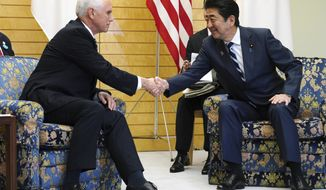 U.S. Vice President Mike Pence, left, meets Japanese Prime Minister Shinzo Abe at Abe's official residence in Tokyo Tuesday, Nov. 13, 2018. (AP Photo/Eugene Hoshiko)