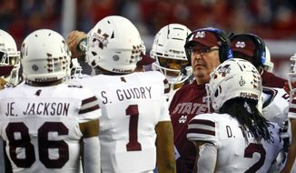 Mississippi State head coach Joe Moorhead talks with players in a timeout during the second half of an NCAA college football game against Alabama, Saturday, Nov. 10, 2018, in Tuscaloosa, Ala. (AP Photo/Butch Dill)