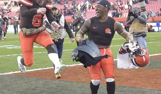 FILE - In this Nov. 11, 2018, file photo, Cleveland Browns quarterback Baker Mayfield (6) and strong safety Damarious Randall celebrate after a 28-16 win over the Atlanta Falcons in an NFL football game, in Cleveland. Mayfield threw a season-high three touchdown passes as the Browns ended a four-game losing streak with their best all-around performance in years. (AP Photo/David Richard, File)