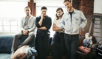 """In this Sept. 28, 2018 photo, members of Mumford & Sons, from left, Ben Lovett, Marcus Mumford, Winston Marshall and Ted Dwane pose for a portrait in New York to promote their fourth album """"Delta."""" (Photo by Victoria Will/Invision/AP)"""