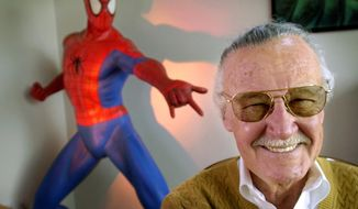 "In this April 16, 2002, file photo, Stan Lee, 79, creator of comic-book franchises such as ""Spider-Man,"" ""The Incredible Hulk"" and ""X-Men,"" smiles during a photo session in his office in Santa Monica, Calif. Comic book genius Lee, the architect of the contemporary comic book, has died. He was 95.  (AP Photo/Reed Saxon, File)"
