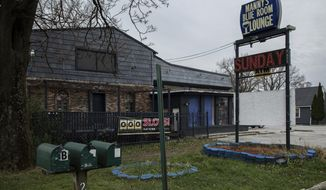 Manny's Blue Room Lounge in Robbins on Monday, Nov. 12, 2018. A police officer fatally shot an armed security guard while responding to an early-morning shooting at a suburban Chicago bar, investigators said. Officers responded shortly after 4 a.m. Sunday to a call of shots fired at Manny's Blue Room in Robbins, just south of Chicago. An officer from nearby Midlothian shot the security guard, who was later identified as 26-year-old Jemel Roberson, according to Cook County Sheriff's Office spokeswoman Sophia Ansari. (Zbigniew Bzdak/Chicago Tribune via AP)