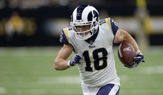 FILE - In this Nov. 4, 2018, file photo, Los Angeles Rams wide receiver Cooper Kupp (18) carries for a touchdown in the second half of an NFL football game against the New Orleans Saints, in New Orleans. Kupp is out for the season after tearing a ligament in his left knee. Coach Sean McVay on Monday, Nov. 12, 2018, confirmed the injury for Kupp, who led the Rams in yards receiving last season. Kupp was hurt on a noncontact play during the Rams' 36-31 victory over the Seattle Seahawks. (AP Photo/Bill Feig, FIle)