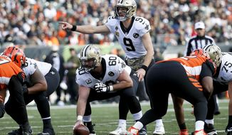New Orleans Saints quarterback Drew Brees (9) directs his players before the snap in the first half of an NFL football game against the Cincinnati Bengals, Sunday, Nov. 11, 2018, in Cincinnati. (AP Photo/Frank Victores)