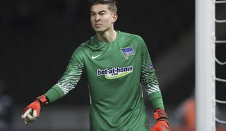 FILE - In this Dec. 7, 2017, file photo, Hertha goalkeeper Jonathan Klinsmann gestures during the Europa League Group J soccer match between Hertha BSC and Ostersunds FK in Berlin, Germany. Jonathan Klinsmann, the son of former American coach Jurgen Klinsmann, has been added to the U.S. roster for exhibition games against England and Italy and could make his national team debut.(AP Photo/Michael Sohn, File)