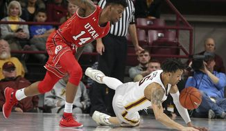 Minnesota's Amir Coffey, right, and Utah's Vante Hendrix chase the loose ball in the first half of an NCAA college basketball game Monday, Nov. 12, 2018, in Minneapolis. (AP Photo/Jim Mone)